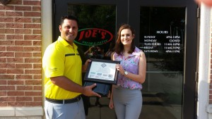 Joey Trupiano of Joe's Pizza Presents the Hall of Fame Award to Madeline Aherin of Dieterich High School