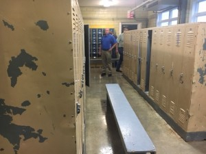 Teutopolis Board Members inspect the High School boy's locker room.