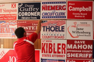 Effingham County Republican Chairman Rob Arnold post campaign signs.