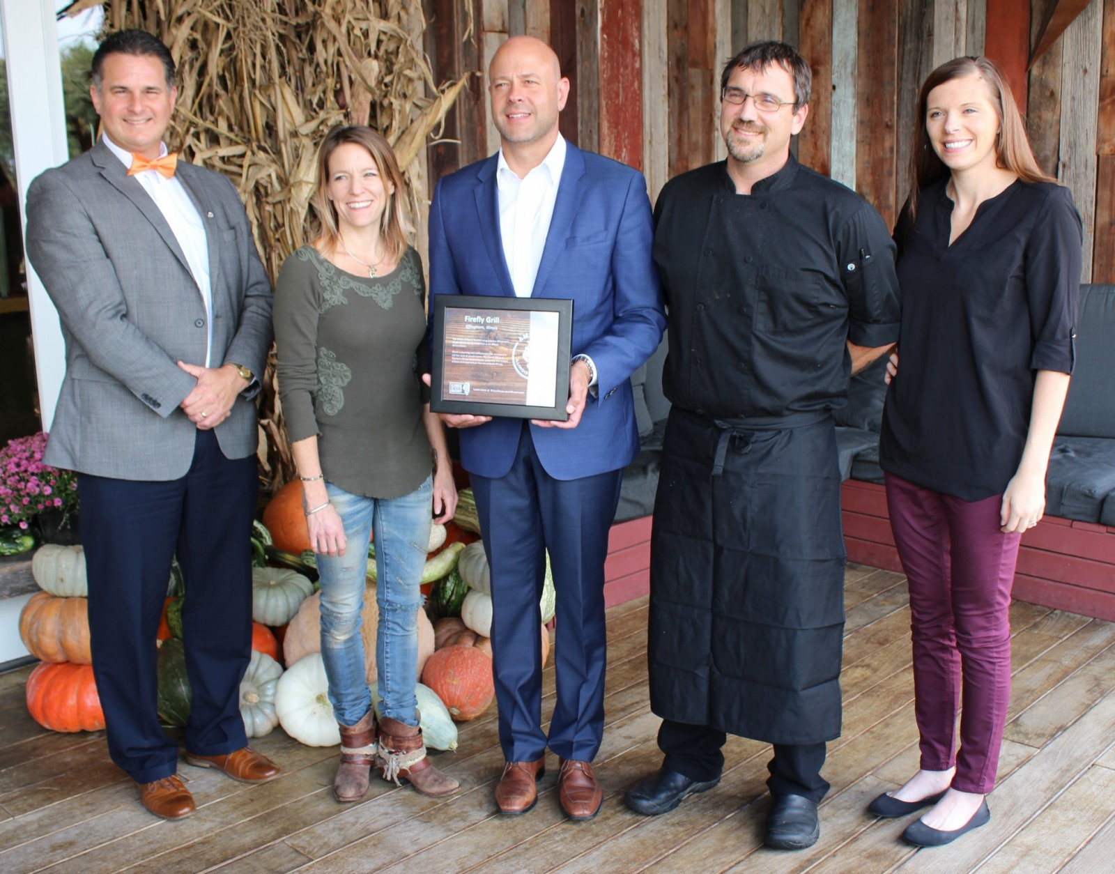 "Cory Jobe officially recognizes the Firefly Grill as an ""Illinois Maker"" (Pictured L-R) Effingham Mayor Jeff Bloemker, Firefly Co-owner Kristie Campbell, Illinois Tourism Director Cory Jobe, Firefly Co-owner and Chef Naeel Campbell, Effingham Tourism Director Jodi Thoele."