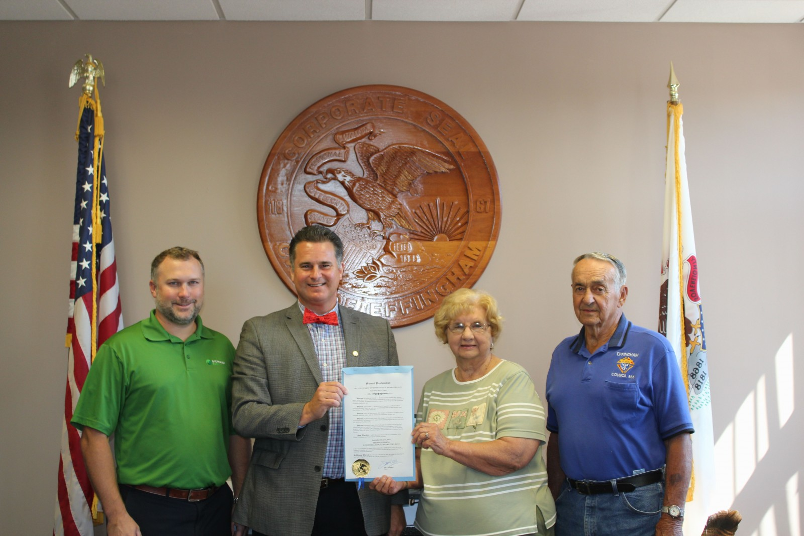 Mayor Bloemker and Mary Ann and Grand Knight Jim Bierman, and ID Drive Committee member Jason Semple.
