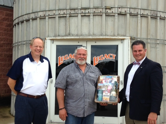 (L-R) Economic Development Director Todd Hull, Legacy Harley Owner Paul Gutman, Mayor Jeff Bloemker