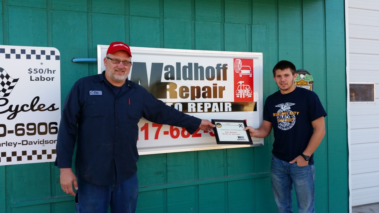 "Tim Waldhoff presents Trey Buzzard with the ""Top Shop"" Award."
