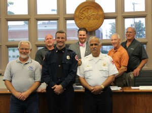 Back Row L-R Commissioner Kevin Willis; Mayor Jeff Bloemker; Commissioner Merv Gillenwater; Commissioner Don Althoff. Front Row L-R: David Storm; Matthew Carpenter; Fire Chief Joe Holomy