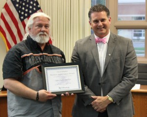 Legacy Harley Davidson Owner Paul Gutman receives the Business Appreciation Award from Mayor Jeff Bloemker