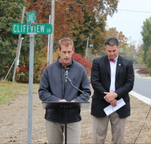 City Engineer Jeremy Heuerman and Mayor Jeff Bloemker dedicate N. Raney Street Thursday morning.