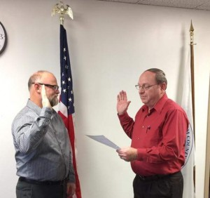 County Clerk Kerry Hirtzel swear in John Perry to the Effingham County Board. Photo courtesy of Elizabeth Huston.