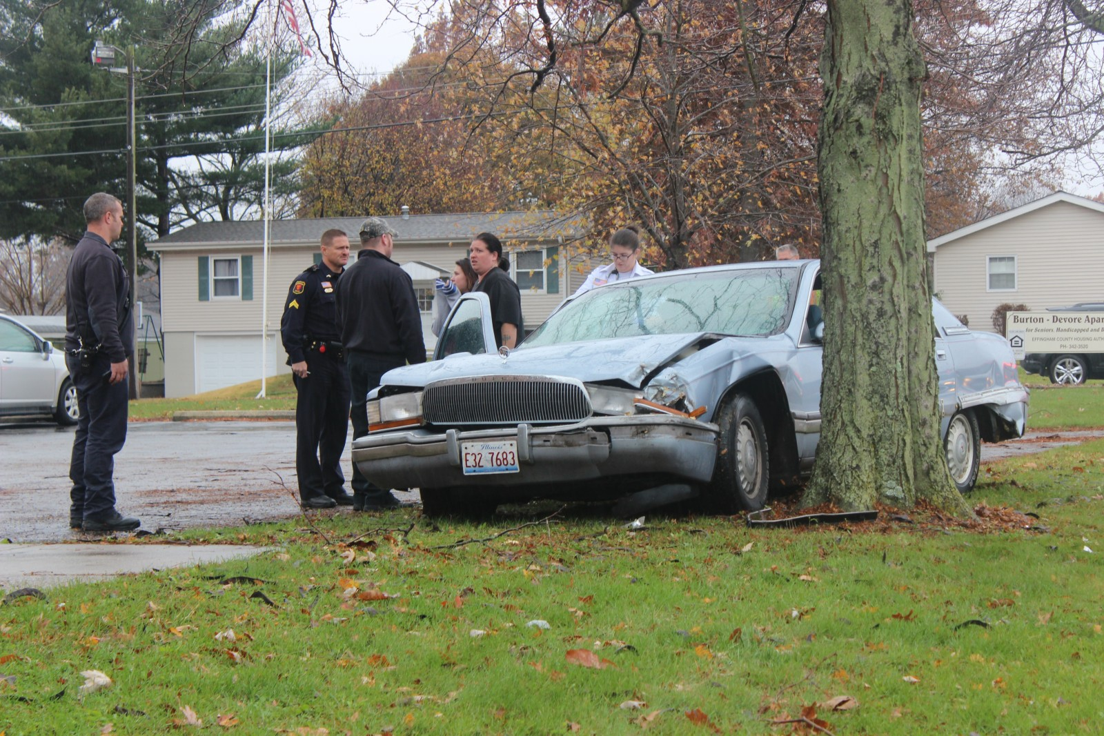 Paramedics and Police inspect a vehicle that collided with a tree on Temple Avenue.